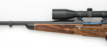 7mm left handed custom rifle with fleur-de-lis checkering