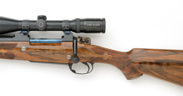 7mm left handed rifle with nitre blue bolt and color cased shroud