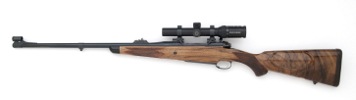375 Custom rifle with express sights- barrel band- iron sights- leather wrapped pad and drop box magazine