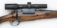 375 right handed custom rifle with Schmidt & Bender scope
