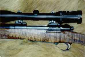 25.06 Mauser action squared bridged with fiddle back clarol walnut stock