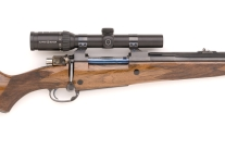 416 Rigby custom rifle with color case shroud and checkered bolt handle