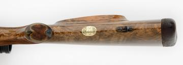 30.06 custom rifle with gold initial plate-engraving and skeleton grip cap