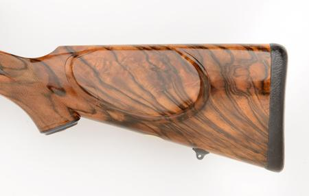 375 custom rifle with cheek piece and leather wrapped pad