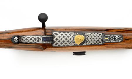 375 Todd Ramirez rifle with celtic engraving and gold lion